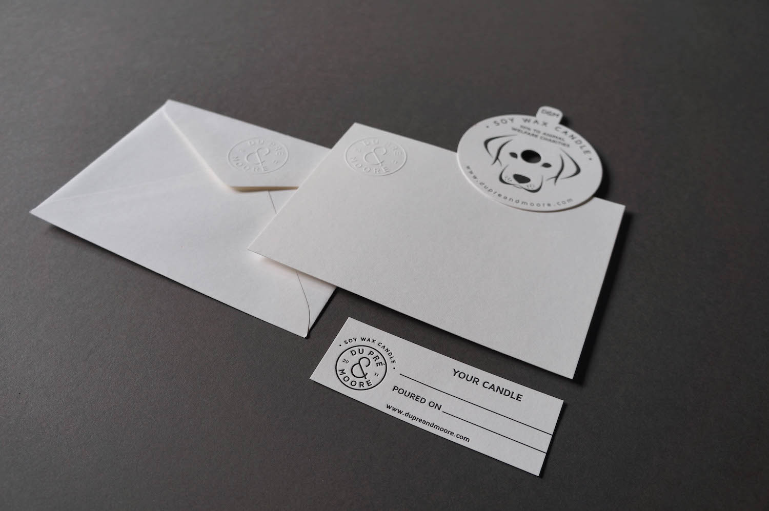 blind-emboss-logo-letterpress-dupremoore-business-collateral-candles-soy-wax