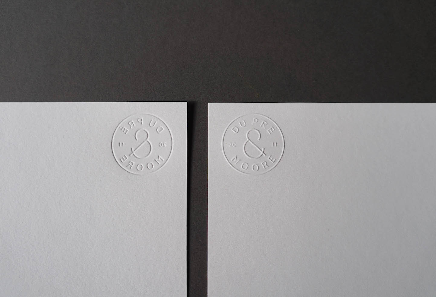 blind-emboss-logo-letterpress-dupremoore-with-comps
