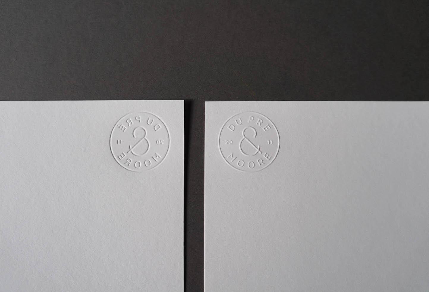blind-emboss-logo-letterpress-dupremoore-with-comps